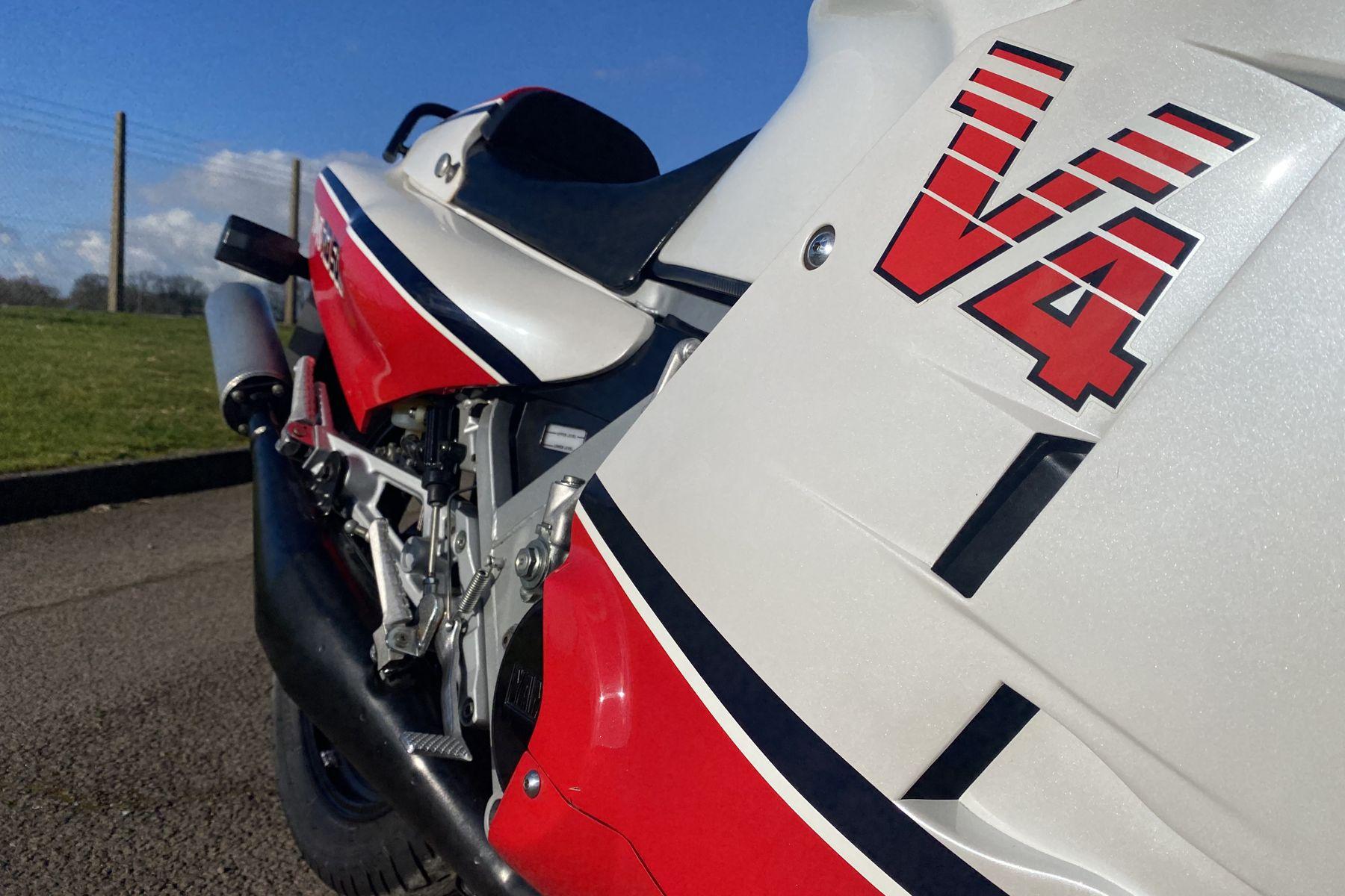 Image may contain motorcycle, racing memorabilia, vehicle performance parts