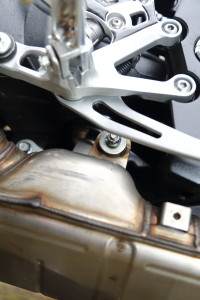 Stock GSX-S1000 silencer bolt is a pain to reach behind the brake pedal